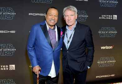 "HOLLYWOOD, CALIFORNIA - DECEMBER 16: (L-R) Billy Dee Williams and Harrison Ford arrive for the World Premiere of ""Star Wars: The Rise of Skywalker"", the highly anticipated conclusion of the Skywalker saga on December 16, 2019 in Hollywood, California. (Photo by Charley Gallay/Getty Images for Disney)"