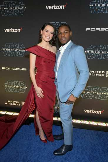 "HOLLYWOOD, CALIFORNIA - DECEMBER 16: (L-R) Daisy Ridley and John Boyega arrive for the World Premiere of ""Star Wars: The Rise of Skywalker"", the highly anticipated conclusion of the Skywalker saga on December 16, 2019 in Hollywood, California. (Photo by Charley Gallay/Getty Images for Disney)"