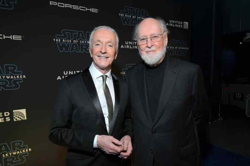 "HOLLYWOOD, CALIFORNIA - DECEMBER 16: (L-R) Anthony Daniels and composer John Williams arrive for the World Premiere of ""Star Wars: The Rise of Skywalker"", the highly anticipated conclusion of the Skywalker saga on December 16, 2019 in Hollywood, California. (Photo by Charley Gallay/Getty Images for Disney)"