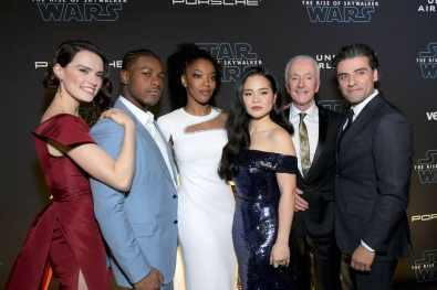 "HOLLYWOOD, CALIFORNIA - DECEMBER 16: (L-R) Daisy Ridley, John Boyega, Naomi Ackie, Kelly Marie Tran, Anthony Daniels and Oscar Isaac arrive for the World Premiere of ""Star Wars: The Rise of Skywalker"", the highly anticipated conclusion of the Skywalker saga on December 16, 2019 in Hollywood, California. (Photo by Charley Gallay/Getty Images for Disney)"