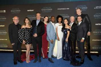 "HOLLYWOOD, CALIFORNIA - DECEMBER 16: (L-R) Ian McDiarmid, Keri Russell, Richard E. Grant, Daisy Ridley, John Boyega, Naomi Ackie, Kelly Marie Tran, Anthony Daniels, Joonas Suotamo, and Oscar Isaac arrive for the World Premiere of ""Star Wars: The Rise of Skywalker"", the highly anticipated conclusion of the Skywalker saga on December 16, 2019 in Hollywood, California. (Photo by Charley Gallay/Getty Images for Disney)"
