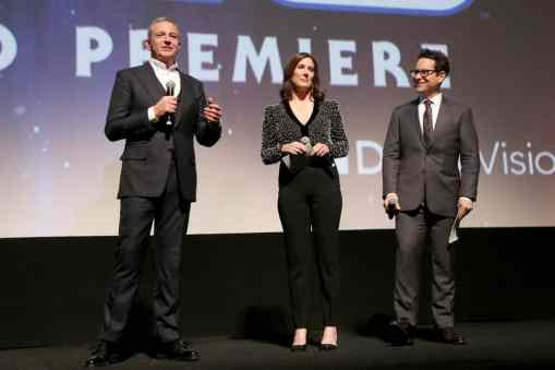 "HOLLYWOOD, CALIFORNIA - DECEMBER 16: (L-R) The Walt Disney Company Chairman and CEO Bob Iger, Producer and President of Lucasfilm Kathleen Kennedy and Director, Writer and Producer J.J. Abrams speak onstage during the World Premiere of ""Star Wars: The Rise of Skywalker"", the highly anticipated conclusion of the Skywalker saga on December 16, 2019 in Hollywood, California. (Photo by Jesse Grant/Getty Images for Disney)"