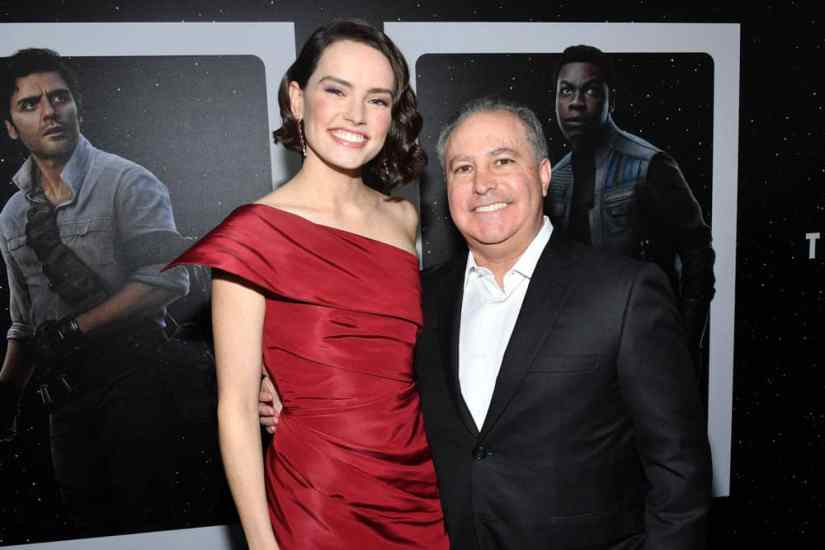 "HOLLYWOOD, CALIFORNIA - DECEMBER 16: Daisy Ridley and Co-Chairman, The Walt Disney Studios Alan Bergman arrive for the World Premiere of ""Star Wars: The Rise of Skywalker"", the highly anticipated conclusion of the Skywalker saga on December 16, 2019 in Hollywood, California. (Photo by Amy Sussman/Getty Images for Disney)"