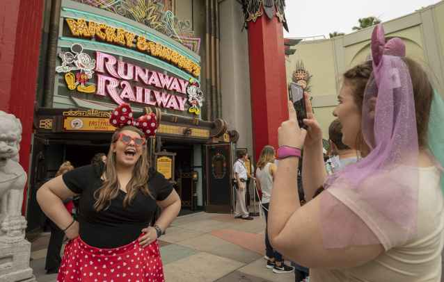 Many guests dressed in Mickey- and Minnie-themed attire to visit Disney's Hollywood Studios on March 4,2020, for the opening day of Mickey & Minnie's Runaway Railway. The family-friendly new adventure at Walt Disney World Resort is the first ride-through attraction in a Disney park starring Mickey Mouse and Minnie Mouse. (Kent Phillips, photographer)