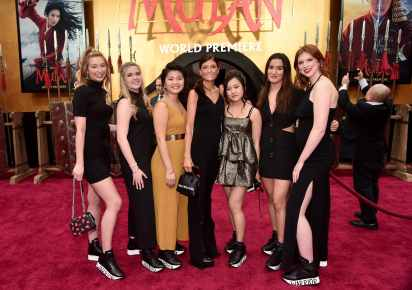 HOLLYWOOD, CALIFORNIA - MARCH 09: Ruthie Davis (C) and University of Delaware students attend the World Premiere of Disney's 'MULAN' at the Dolby Theatre on March 09, 2020 in Hollywood, California. (Photo by Alberto E. Rodriguez/Getty Images for Disney)
