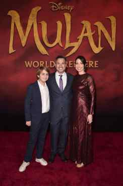 HOLLYWOOD, CALIFORNIA - MARCH 09: (L-R) Guest, Producer Jake Weiner, and Maurine Slutsky attend the World Premiere of Disney's 'MULAN' at the Dolby Theatre on March 09, 2020 in Hollywood, California. (Photo by Alberto E. Rodriguez/Getty Images for Disney)