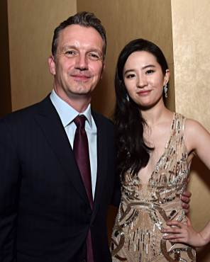 HOLLYWOOD, CALIFORNIA - MARCH 09: President of Walt Disney Studios Motion Picture Production Sean Bailey and Yifei Liu attend the World Premiere of Disney's 'MULAN' at the Dolby Theatre on March 09, 2020 in Hollywood, California. (Photo by Alberto E. Rodriguez/Getty Images for Disney)