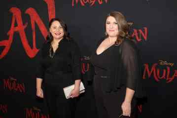 HOLLYWOOD, CALIFORNIA - MARCH 09: (L-R) Screenwriters Elizabeth Martin and Lauren Hynek attend the World Premiere of Disney's 'MULAN' at the Dolby Theatre on March 09, 2020 in Hollywood, California. (Photo by Jesse Grant/Getty Images for Disney)