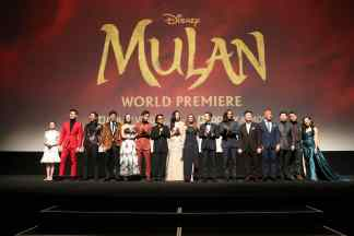 HOLLYWOOD, CALIFORNIA - MARCH 09: (L-R) Crystal Rao, Chen Tang, Nelson Lee, Jimmy Wong, Rosalind Chao, Yoson An, Jet Li, Yifei Liu, Director Niki Caro, Donnie Yen, Jason Scott Lee, Tzi Ma, Ron Yuan, Jun Yu, Doua Moua, and Xana Tang speak onstage during the World Premiere of Disney's 'MULAN' at the Dolby Theatre on March 09, 2020 in Hollywood, California. (Photo by Jesse Grant/Getty Images for Disney)