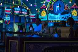 """Guests visit an action-packed carnival as part of their journey aboard Mickey & Minnie's Runaway Railway, opening March 4, 2020, in Disney's Hollywood Studios at Walt Disney World Resort in Lake Buena Vista, Fla. The first ride-through attraction in Disney history featuring Mickey Mouse and Minnie Mouse brings guests into the vibrant world of """"Mickey Mouse"""" cartoon shorts. (Matt Stroshane, photographer)"""