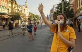 Disney cast members welcome guests to Magic Kingdom Park, July 11, 2020, at Walt Disney World Resort in Lake Buena Vista, Fla., on the first day of the theme park's phased reopening. (Kent Phillips, Photographer)