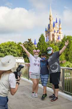 Guests stop to take a photo at Magic Kingdom Park, July 11, 2020, at Walt Disney World Resort in Lake Buena Vista, Fla., on the first day of the theme park's phased reopening. (Matt Stroshane, photographer)