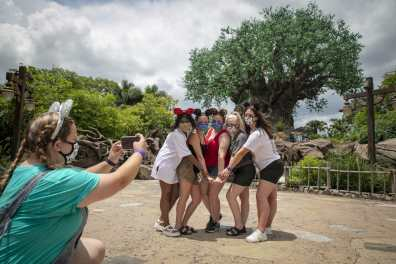 Guests stop to take a photo at Disney's Animal Kingdom Theme Park, July 11, 2020, at Walt Disney World Resort in Lake Buena Vista, Fla., on the first day of the theme park's phased reopening. (Olga Thompson, Photographer)