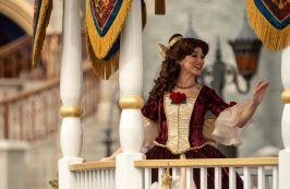 Dressed in her holiday finest, Belle waves to guests during a cavalcade down Main Street, U.S.A., with other Disney princesses as part of the holiday celebrations at Magic Kingdom Park at Walt Disney World Resort in Lake Buena Vista, Fla. (Kent Phillips, photographer)