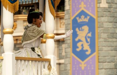 Dressed in her holiday finest, Tiana waves to guests during a cavalcade down Main Street, U.S.A., with other Disney princesses as part of the holiday celebrations at Magic Kingdom Park at Walt Disney World Resort in Lake Buena Vista, Fla. (Kent Phillips, photographer)
