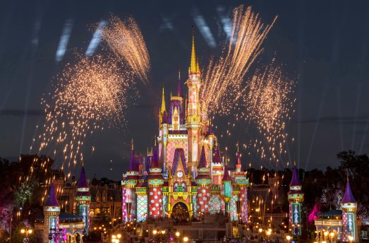 \Pyrotechnic pixie-dust moments add occasional bursts of merriment each night at Magic Kingdom Park as projection effects transform Cinderella Castle with a flourish of holiday cheer. These magical holiday touches occur throughout the night as part of the seasonal celebrations happening across Walt Disney World Resort in Lake Buena Vista, Fla., through Dec. 30, 2020. (Kent Phillips, photographer)