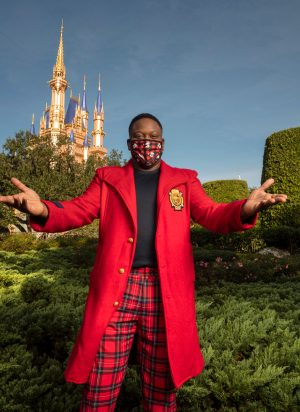 """Singer and actor Tituss Burgess enjoys the holiday cheer at Magic Kingdom Park at Walt Disney World Resort in Lake Buena Vista, Fla., Thursday, Dec. 3, 2020, during a taping of """"The Disney Parks Magical Christmas Celebration."""" The holiday special will air on ABC on Dec. 25, 10am-12pm ET. (Kent Phillips, photographer)"""