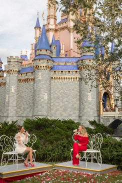 "Country duo Maddie & Tae perform in front of Cinderella Castle at Magic Kingdom Park at Walt Disney World Resort in Lake Buena Vista, Fla., Thursday, Dec. 3, 2020, during a taping of ""The Disney Parks Magical Christmas Celebration."" The holiday special will air on ABC on Dec. 25, 10am-12pm ET. (Kent Phillips , photographer)"