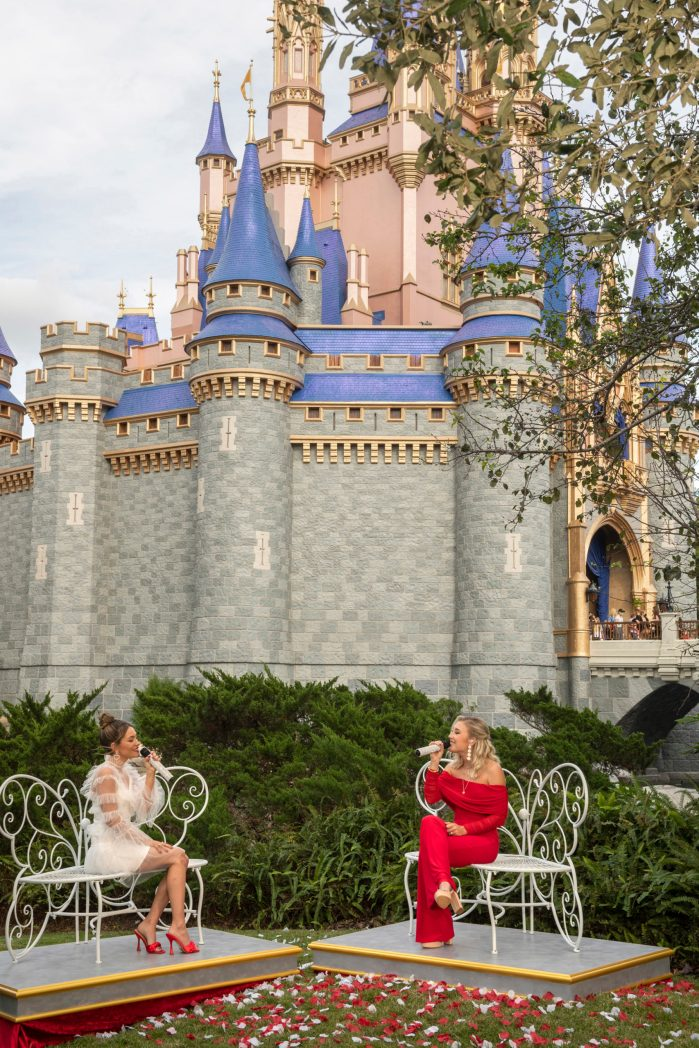 """Country duo Maddie & Tae perform in front of Cinderella Castle at Magic Kingdom Park at Walt Disney World Resort in Lake Buena Vista, Fla., Thursday, Dec. 3, 2020, during a taping of """"The Disney Parks Magical Christmas Celebration."""" The holiday special will air on ABC on Dec. 25, 10am-12pm ET. (Kent Phillips , photographer)"""