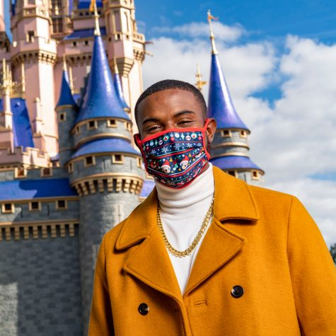 "Singer and actor Trevor Jackson takes a break after performing during a taping of ""The Disney Parks Magical Christmas Celebration"" at Magic Kingdom Park at Walt Disney World Resort in Lake Buena Vista, Fla., Thursday, Dec. 3, 2020. The holiday special will air on ABC on Dec. 25, 10am-12pm ET. (Matt Stroshane, photographer)"