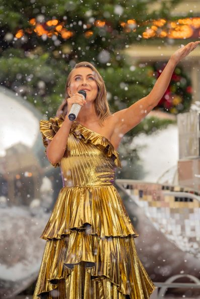 "Julianne Hough performs with Tituss Burgess at Magic Kingdom Park Magic Kingdom Park at Walt Disney World Resort in Lake Buena Vista, Fla., Friday, Dec. 4, 2020, during a taping of ""The Disney Parks Magical Christmas Celebration"" on ABC on Dec. 25, 10am-12pm ET. (Kent Phillips, photographer)"
