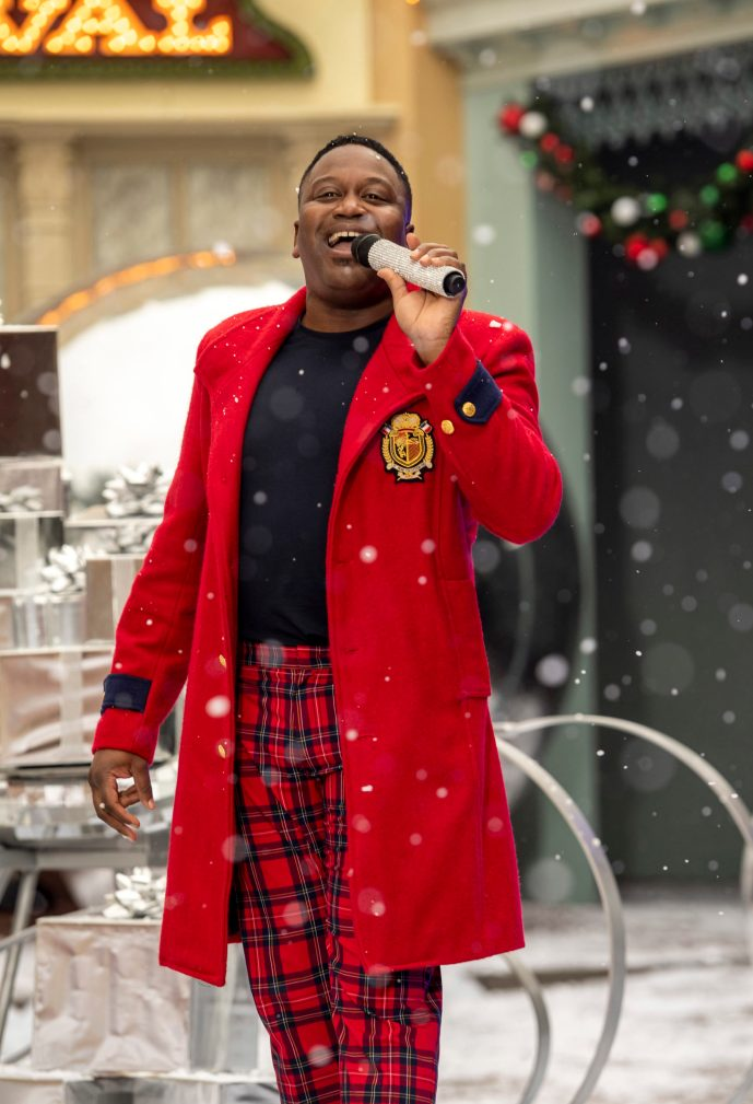 """Tituss Burgess performs with Julianne Hough at Magic Kingdom Park Magic Kingdom Park at Walt Disney World Resort in Lake Buena Vista, Fla., Friday, Dec. 4, 2020, during a taping of """"The Disney Parks Magical Christmas Celebration"""" on ABC on Dec. 25, 10am-12pm ET. (Kent Phillips, photographer)"""
