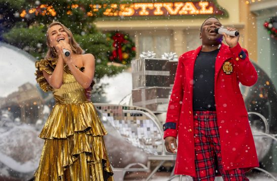 "Julianne Hough and Tituss Burgess perform together during a taping of ""The Disney Parks Magical Christmas Celebration"" from Magic Kingdom Park at Walt Disney World Resort in Lake Buena Vista, Fla. on Friday, Dec. 4, 2020. The holiday special will air on ABC on Dec. 25, 10am-12pm ET. (Kent Phillips, photographer)"