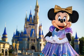 "Beginning Oct. 1, 2021, Minnie Mouse will join Mickey Mouse as hosts of ""The World's Most Magical Celebration"" honoring Walt Disney World Resort's 50th anniversary in Lake Buena Vista, Fla. They will dress in sparkling new looks custom made for the 18-month event, highlighted by embroidered impressions of Cinderella Castle on multi-toned, EARidescent fabric punctuated with pops of gold. (Matt Stroshane, photographer)"