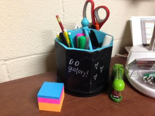 I found this spinning desk organizer at TJ Maxx (it was originally white). I used chalkboard spray paint to cover the outside; now I have a unique surface to doodle on!