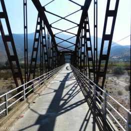 crossing a narrow railway bridge near Pedegua