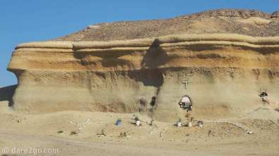 north of Puerto Viejo, Chile: 3 shrines carved into a sandstone cliff.
