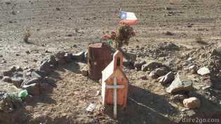 next to a gravel road to Freirina, Chile: a church shaped shrine.