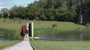 "The bridge across the pond of the Pablo Atchugarry sculpture park: ""Cavernaculum' by Octavio Podestá, 2007"