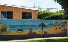 Wall with beach scene mural in 25 de Agosto