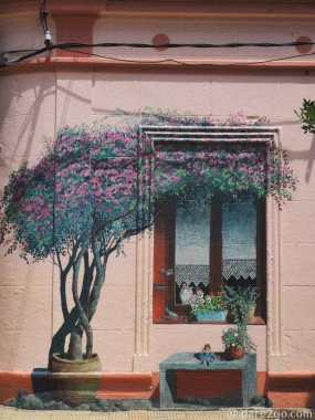 Trompe L'Oeil window mural, painted onto a bricked-up door. One of the over 60 murals in Villa 25 de Agosto