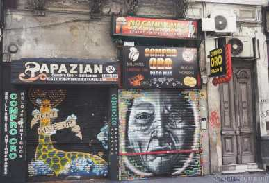 Street Art Calle Libertad: two differently decorated small shop fronts, side-by-side