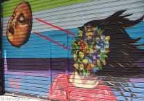Street Art Calle Libertad: another colourful decoration on a roller shutter