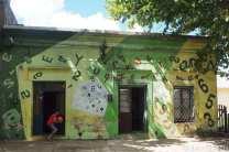 The mural covers this house in letters and numbers. This is actually up the street from the Hotel San Gregorio.