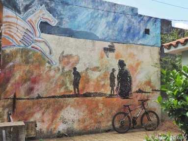 Streetart in San Gregorio: a courtyard wall with a pegasus