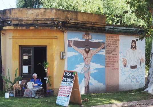 This grandma, sitting outside talking with her birds, was really keen to point out the christian mural on her house.