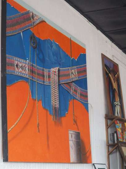 Inside the hotel you can find this concept painting of the mural which covers the water tower.