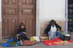 Everywhere in Sucre you find native women squatting on the footpaths or in entrances, selling their wares.