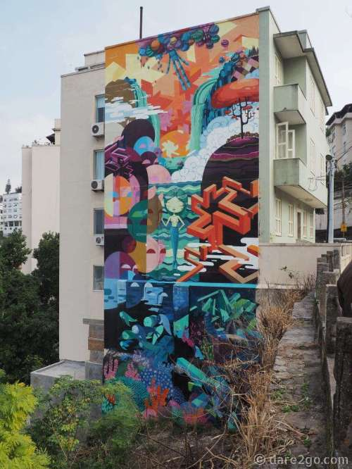 Commissioned mural on a freshly renovated apartment building in Santa Teresa.