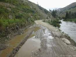 Water often comes gushing down the slopes, hitting the road, and creating a muddy wet mess.