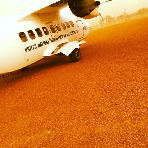 Now boarding at Goz Beida Airport.