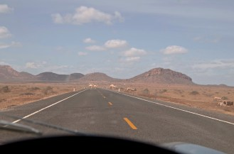 Camels on the road, and Turbi in in distance.