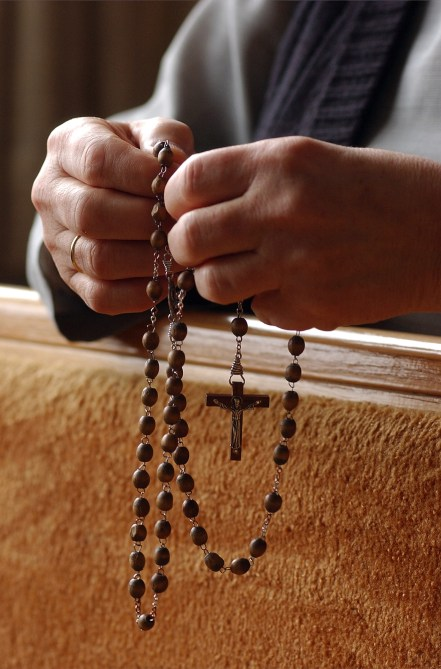 """Rosary beads are held by Sister Cecilia Polt during prayer time in one of the chapels at the monastery. The rosary is a mantra prayer that helps one meditate on the mysteries of Jesus. SUMMARY: """"LIFE INSIDE THE IMMACULATA MONASTERY"""" """"So faith, hope, love remain, these three: but the greatest of these is love."""" -- 1st Corinthians 13:13. The 40 Benedictine sisters of the Immaculata Monastery in Norfolk live by that Bible verse. They start and end each day with prayer. These images are just a small glimpse into their lives."""