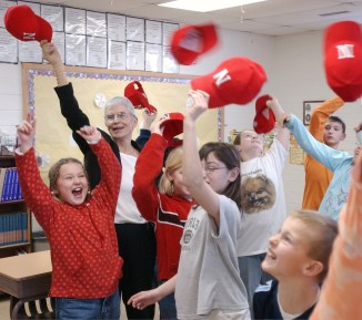 Teacher Mary Lou Beeson and her fourth grade class throw their hats in the air in celebration of her winning a long battle with breast cancer on Jan. 10, 2004. The Wisner students supported her teacher with her battle with cancer, and celebrated by having a party when she was done with treatment and pronounced cancer free.