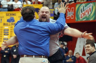 Norfolk assistant coach Craig Schmeckpeper, right, puts his arms out to hug head coach Tony Brown after Josh Pospisil defeated Jared Gable of Papillion-LaVista in their class A 215lb semifinal match Feb. 21, 2003, earning Pospisil a spot in the championships.