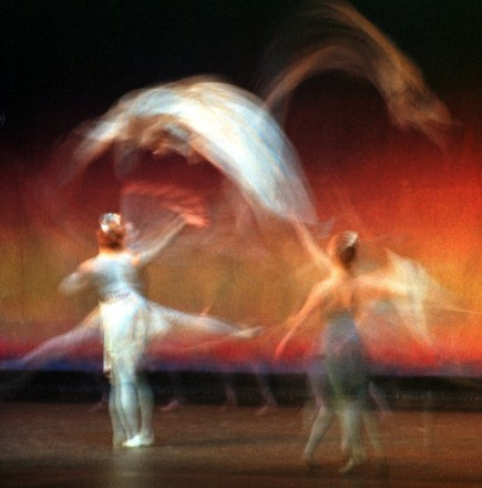 Ballet dancers throw scarves through the air during the New York Theatre Ballet performance Tuesday night, Jan. 22,2002.